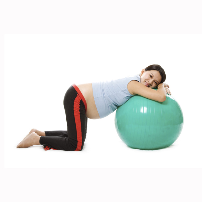 A pregnant woman doing relaxation with birth ball